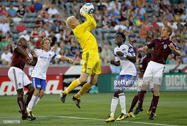 Goal keeper Jimmy Nielsen of the Kansas City Wizards collects the ball as teammates Michael Harrington and Kei Kamara along with Omar Cummings and...