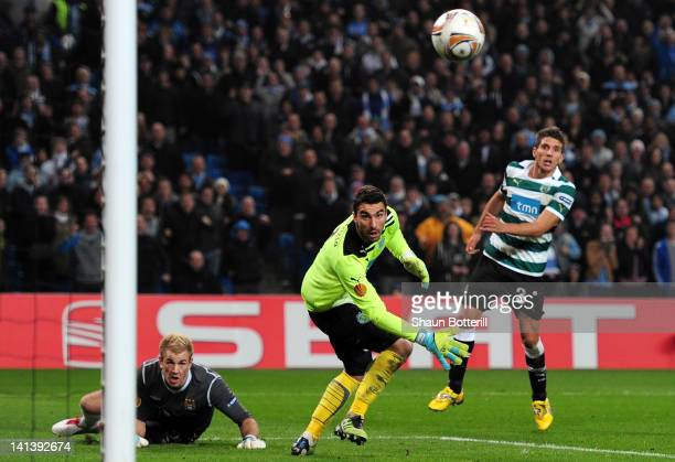 Goal keeper Joe Hart of Man City heads the ball just wide of the post during the UEFA Europa League round of 16 second leg match between Manchester...