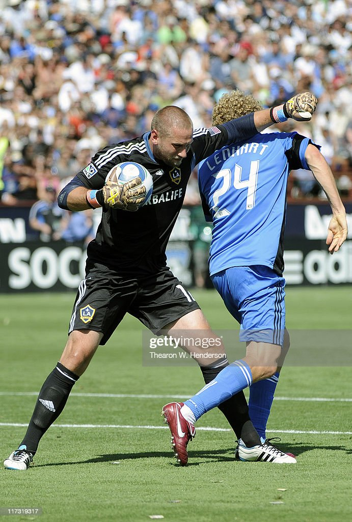 Goal Keeper Josh Saunders of the Los Angeles Galaxy gets red carded and for elbowing in the back of the head Steven Lenhart of the San Jose...