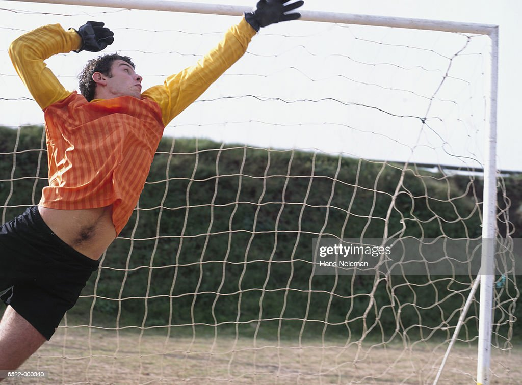 Goal Keeper Jumping : Stock Photo