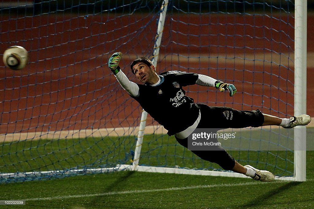 Goal keeper <a gi-track='captionPersonalityLinkClicked' href=/galleries/search?phrase=Mariano+Andujar&family=editorial&specificpeople=804546 ng-click='$event.stopPropagation()'>Mariano Andujar</a> of Argentina's national football team defends the goal team during a team training session on June 18, 2010 in Pretoria, South Africa.