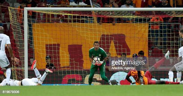 Goal keeper of Galatasaray Fernando Muslera prevents a goal during the UEFA Europa League second qualifying round return match between Galatasaray...
