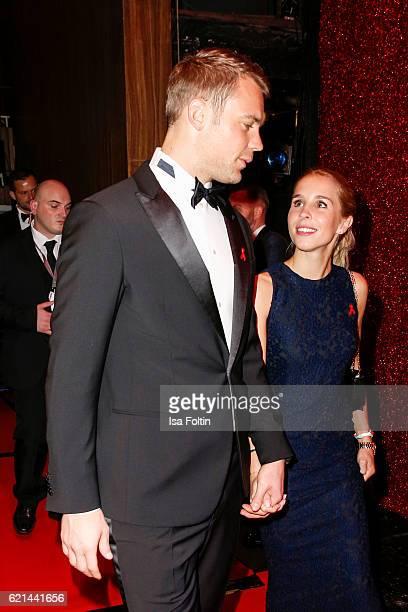 Goal keeper of the national soccer team Manuel Neuer and his girlfriend Nina Weiss arrive at the 23rd Opera Gala at Deutsche Oper Berlin on November...