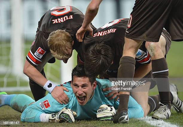 Goal keeper Phillipp Tschauner of Pauli celebrates scoring his goal during the second Bundesliga match between FC St Pauli and SC Paderborn 07 at...