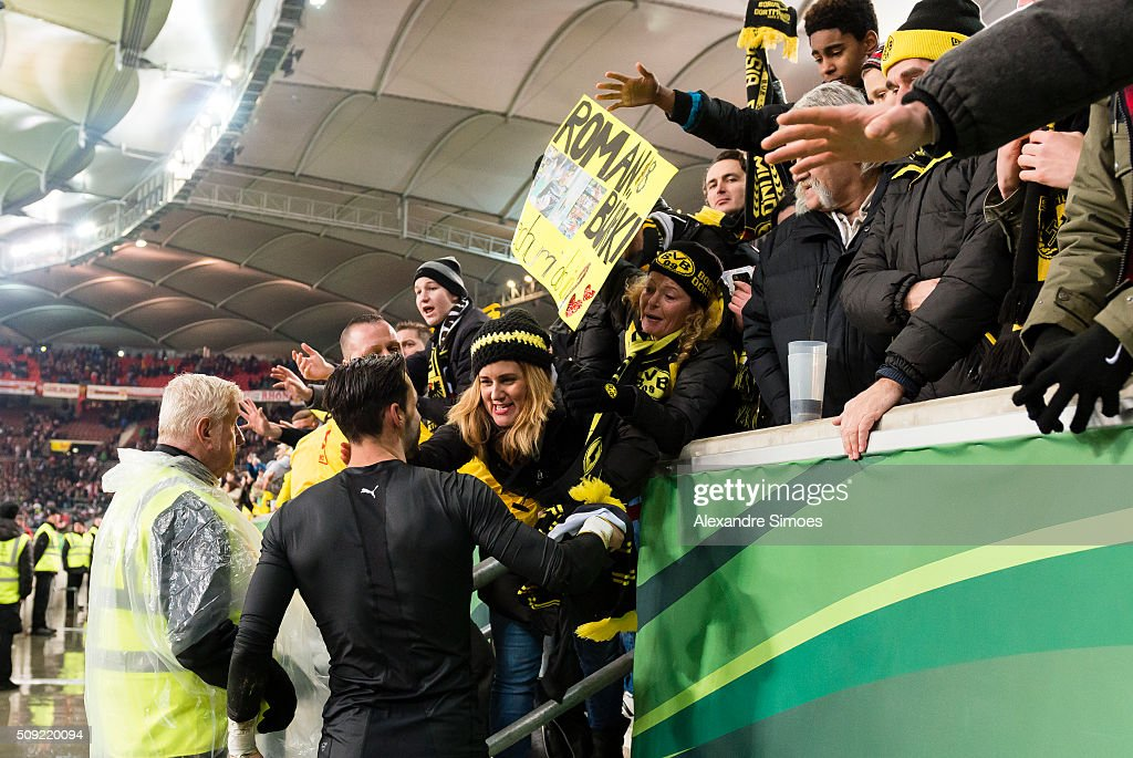 Goal keeper Roman Buerki of Borussia Dortmund gives his shirt to a fan after the final whistle during the DFB Cup match between VfB Stuttgart and Borussia Dortmund at Mercedes-Benz Arena on February 09, 2016 in Stuttgart, Germany.