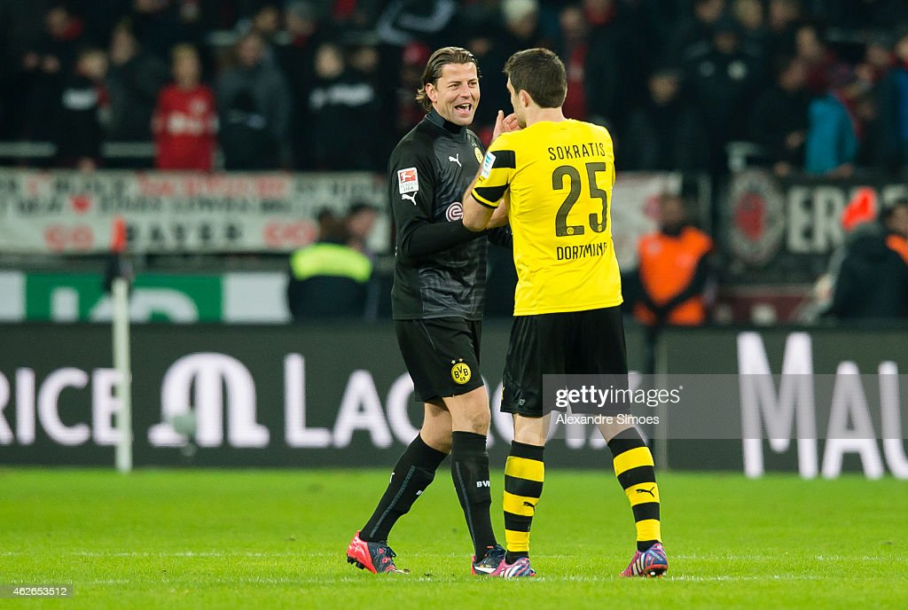 Goal keeper <a gi-track='captionPersonalityLinkClicked' href=/galleries/search?phrase=Roman+Weidenfeller&family=editorial&specificpeople=726753 ng-click='$event.stopPropagation()'>Roman Weidenfeller</a> and <a gi-track='captionPersonalityLinkClicked' href=/galleries/search?phrase=Sokratis+Papastathopoulos+-+Soccer+Player&family=editorial&specificpeople=4426771 ng-click='$event.stopPropagation()'>Sokratis Papastathopoulos</a> of Borussia Dortmund react after the final whistle during the Bundesliga match between Bayer Leverkusen and Borussia Dortmund at BayArena on JANUARY 31, 2015 in Leverkusen, Germany.