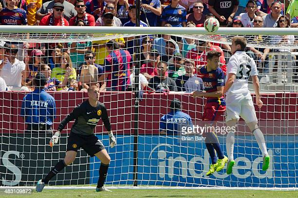 Goal keeper Sam Johnstone of Manchester United watches as Patrick McNair competes with Marc Bartra of FC Barcelona in the second half during the...