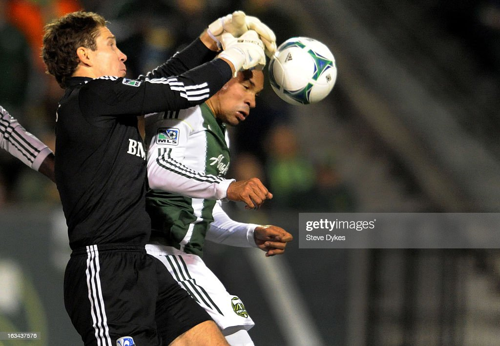 Goal keeper <a gi-track='captionPersonalityLinkClicked' href=/galleries/search?phrase=Troy+Perkins&family=editorial&specificpeople=596206 ng-click='$event.stopPropagation()'>Troy Perkins</a> #1 of Montreal Impact goes up to grab the ball away from Ryan Johnson #9 of Portland Timbers during the second half of the game at Jeld-Wen Field on March 09, 2013 in Portland, Oregon. Montreal woin ther game 2-1.