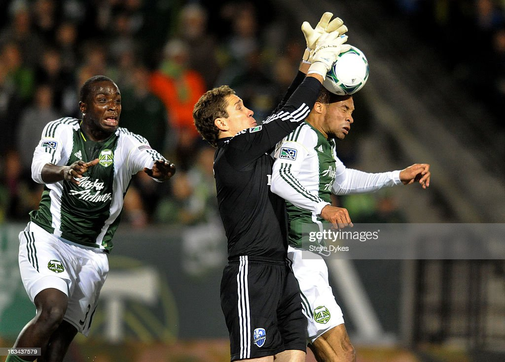 Goal keeper Troy Perkins #1 of Montreal Impact goes up to grab the ball away from Ryan Johnson #9 of Portland Timbers during the second half of the game at Jeld-Wen Field on March 09, 2013 in Portland, Oregon. Montreal woin ther game 2-1.