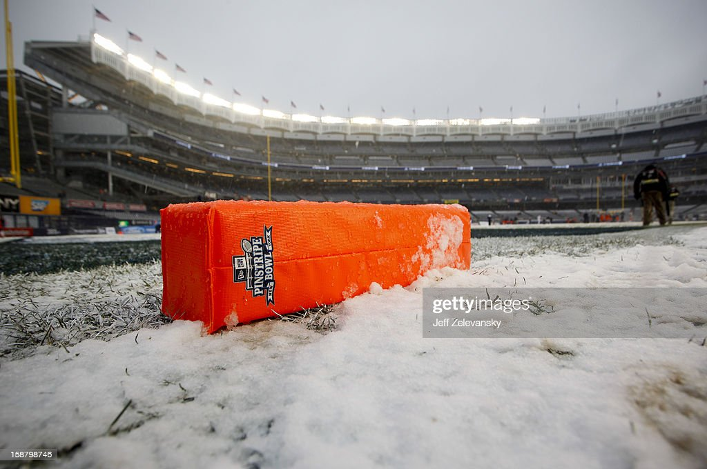 A goal marker lies in the snow before the New Era Pinstripe Bowl between West Virginia Mountaineers and the Syracuse Orange at Yankee Stadium on December 29, 2012 in the Bronx borough of New York City.
