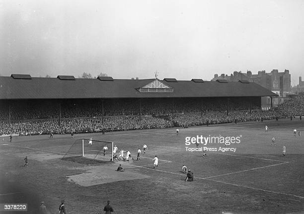 A goal mouth scramble results from a Huddersfield Town corner kick against Preston North End during the last FA Cup Final to be played at Stamford...
