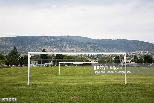 Goal posts in a row in a grass recreation field