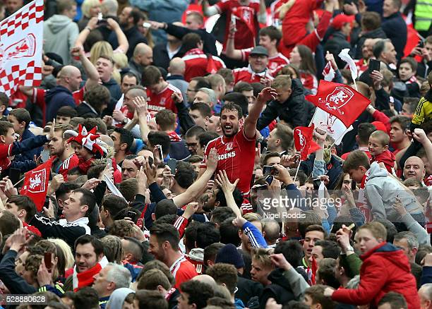 Goal scorer Cristhian Stuani of Middlesbrough celebrates on the shoulders of fans the Sky Bet Championship match between Middlesbrough and Brighton...