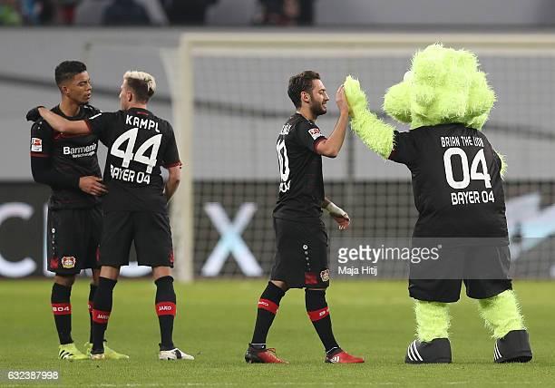 Goal scorer Hakan Calhanoglu of Leverkusen celebrates with the club mascot after the Bundesliga match between Bayer 04 Leverkusen and Hertha BSC at...
