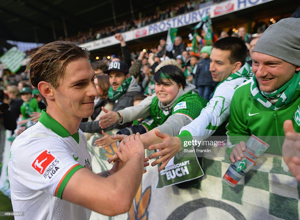 Goal scorer Ludovic Obraniak of Bremen celebrates with fans after the Bundesliga match between Werder Bremen and Borussia Moenchengladbach at Weserstadion on February 15, 2014 in Bremen, Germany.