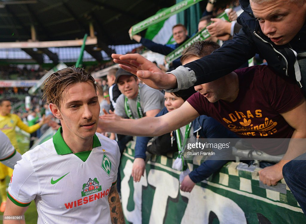 Goal scorer <a gi-track='captionPersonalityLinkClicked' href=/galleries/search?phrase=Ludovic+Obraniak&family=editorial&specificpeople=661174 ng-click='$event.stopPropagation()'>Ludovic Obraniak</a> of Bremen celebrates with fans after the Bundesliga match between Werder Bremen and Borussia Moenchengladbach at Weserstadion on February 15, 2014 in Bremen, Germany.