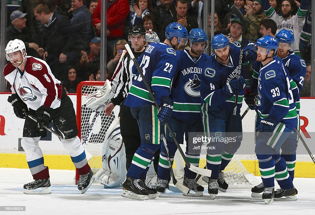 Goal scorer <a gi-track='captionPersonalityLinkClicked' href=/galleries/search?phrase=Zack+Kassian&family=editorial&specificpeople=4604939 ng-click='$event.stopPropagation()'>Zack Kassian</a> #9 of the Vancouver Canucks is congratulated by <a gi-track='captionPersonalityLinkClicked' href=/galleries/search?phrase=Daniel+Sedin&family=editorial&specificpeople=202492 ng-click='$event.stopPropagation()'>Daniel Sedin</a> #22, <a gi-track='captionPersonalityLinkClicked' href=/galleries/search?phrase=Henrik+Sedin&family=editorial&specificpeople=202574 ng-click='$event.stopPropagation()'>Henrik Sedin</a> #33, <a gi-track='captionPersonalityLinkClicked' href=/galleries/search?phrase=Alexander+Edler&family=editorial&specificpeople=882987 ng-click='$event.stopPropagation()'>Alexander Edler</a> #23 and <a gi-track='captionPersonalityLinkClicked' href=/galleries/search?phrase=Dan+Hamhuis&family=editorial&specificpeople=204213 ng-click='$event.stopPropagation()'>Dan Hamhuis</a> #2 as <a gi-track='captionPersonalityLinkClicked' href=/galleries/search?phrase=Jan+Hejda&family=editorial&specificpeople=624333 ng-click='$event.stopPropagation()'>Jan Hejda</a> #8 of the Colorado Avalanche skates away during their NHL game at Rogers Arena January 30, 2013 in Vancouver, British Columbia, Canada. Vancouver won 3-0.