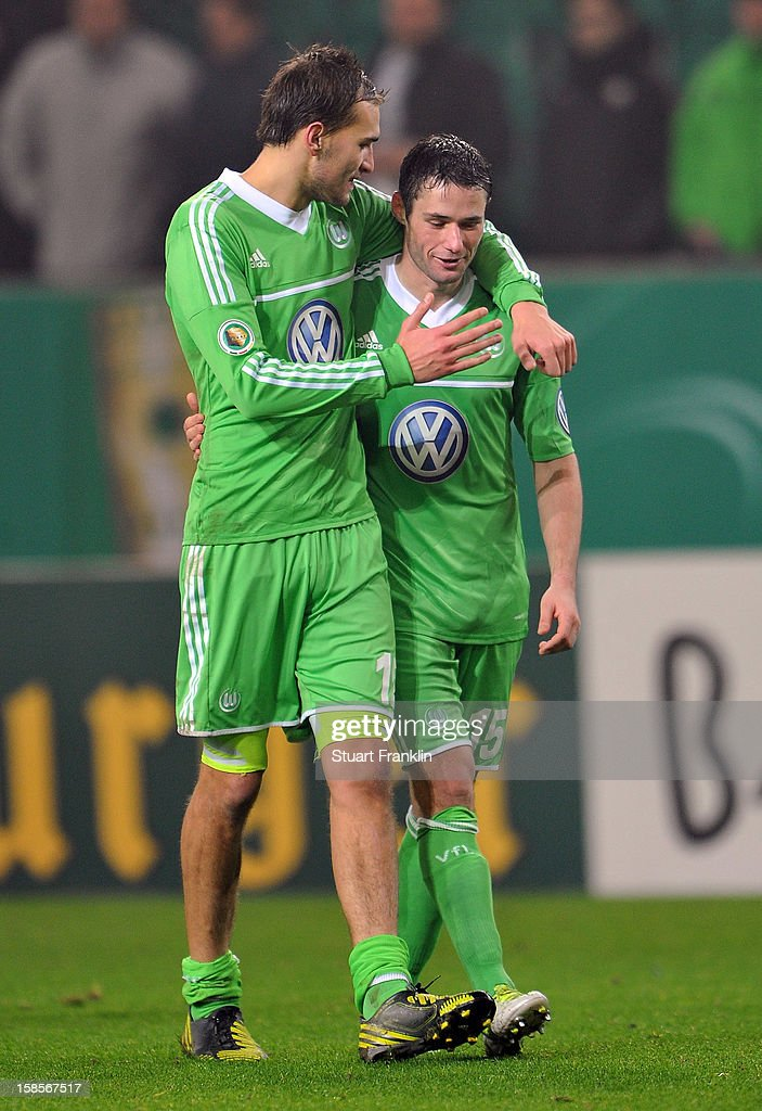 Goal scorers <a gi-track='captionPersonalityLinkClicked' href=/galleries/search?phrase=Bas+Dost&family=editorial&specificpeople=7467816 ng-click='$event.stopPropagation()'>Bas Dost</a> and <a gi-track='captionPersonalityLinkClicked' href=/galleries/search?phrase=Christian+Traesch&family=editorial&specificpeople=5482851 ng-click='$event.stopPropagation()'>Christian Traesch</a> of Wolfsburg celebrate at the end of the round of 16 of the DFB cup match between VfL Wolfsburg and Bayer Leverkusen at Volkswagen Arena on December 19, 2012 in Wolfsburg, Germany.