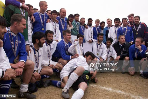 Goal scorers Said Tahir and Sgt Darren Mortimer hug as their teams ISAF and Kabul FC meet after their game at the Olympic Stadium in Kabul...