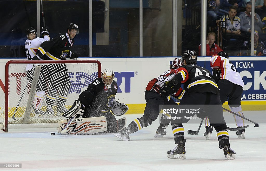 Goal tender Martins Raitums of Nottingham Panthers makes a save during the Champions Hockey League group stage game between Nottingham Panthers and Lulea Hockeyat at the National Ice Centre on August 24, 2014 in Nottingham, England.