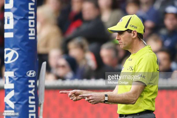 A goal umpire signals a goal during the round 21 AFL match between the Carlton Blues and the Melbourne Demons at Melbourne Cricket Ground on August...