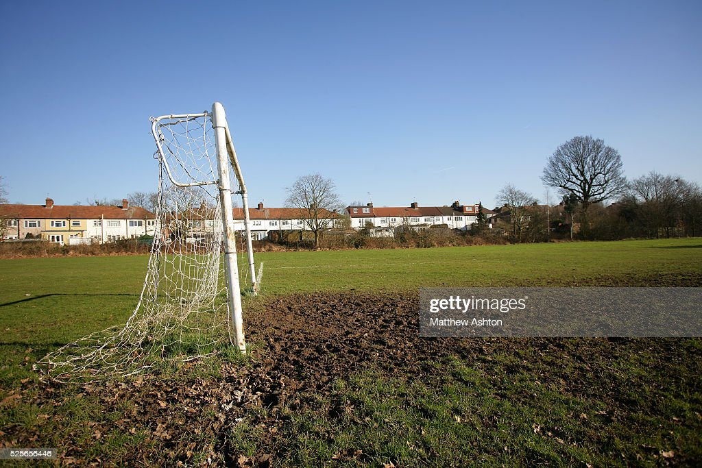 A goal with nets on a field next to Underhill the home stadium of Barnet FC