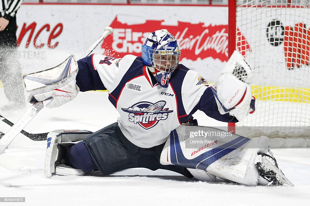 Goaletender Michael DiPietro #64 of the Windsor Spitfires makes a huge glove save against the Owen Sound Attack on November 17, 2016 at the WFCU Centre in Windsor, Ontario, Canada.