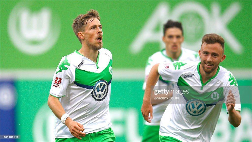 Goalgetter Jannis Plaeschke and Marvin Kleihs of Wolfsburg celebration the goal 1:0 for Wolfsburg during the 3. Liga Playoff Leg 1 match between VfL Wolfsburg II and Jahn Regensburg at AOK Stadion on May 25, 2016 in Wolfsburg, Germany.