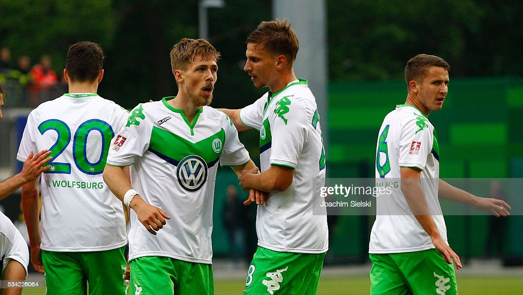 Goalgetter Jannis Plaeschke and Sebastian Wimmer of Wolfsburg celebrate the first goal for Wolfsburg during the 3. Liga Playoff Leg 1 match between VfL Wolfsburg II and Jahn Regensburg at AOK Stadion on May 25, 2016 in Wolfsburg, Germany.