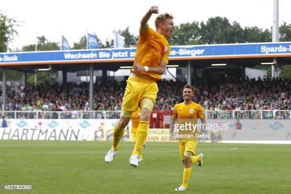 Goalgetter Kai Schwertfeger and David Blacha of Rostock celebrate after 30 during the Third League match between Preussen Muenster and Hansa Rostock...