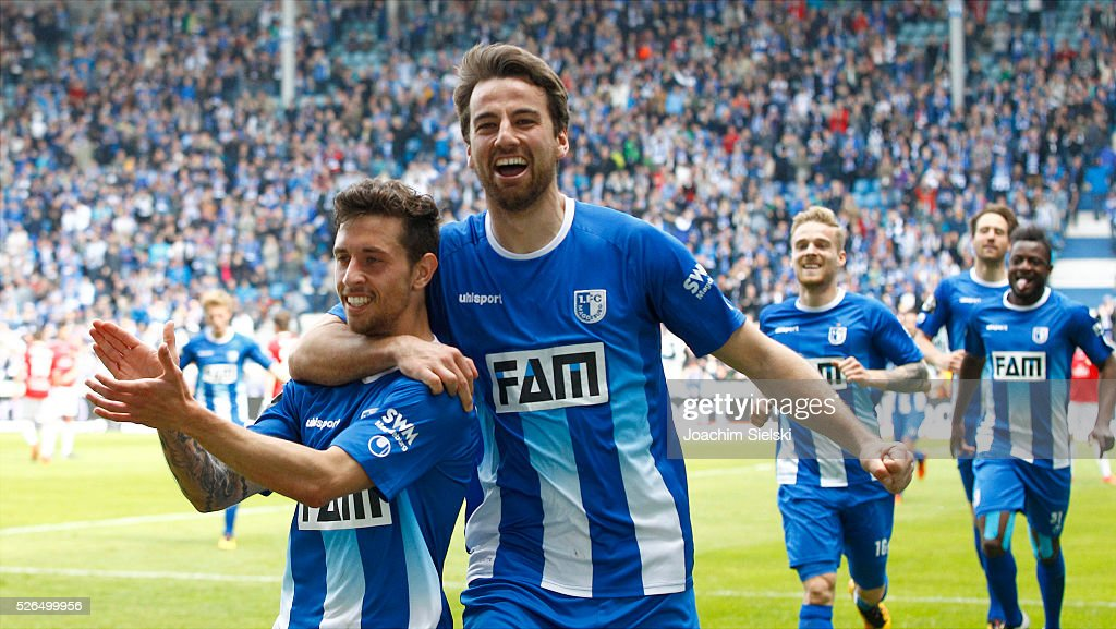 Goalgetter Manuel Farrona-Pulido and Christian Beck of Magdeburg celebration the goal 3:0 for Magdeburg during the Third League match between 1. FC Magdeburg and SG Sonnenhof-Grosssaspach at MDCC-Arena on April 30, 2016 in Magdeburg, Germany.