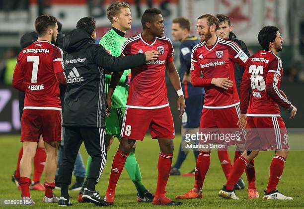 Goalgetter Roger de Oliveira Bernardo of Ingolstadt celebrates with team mates after the Bundesliga match between FC Ingolstadt 04 and RB Leipzig at...