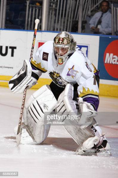 Goalie Adam Hauser of the Manchester Monarchs stands outside the crease during the pregame skate around prior to a American Hockey League game...
