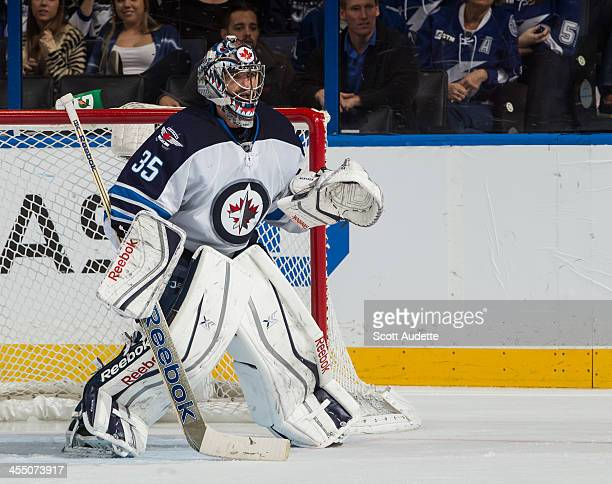Goalie Al Montoya of the Winnipeg Jets readies for a shot against the Tampa Bay Lightning at the Tampa Bay Times Forum on December 7 2013 in Tampa...