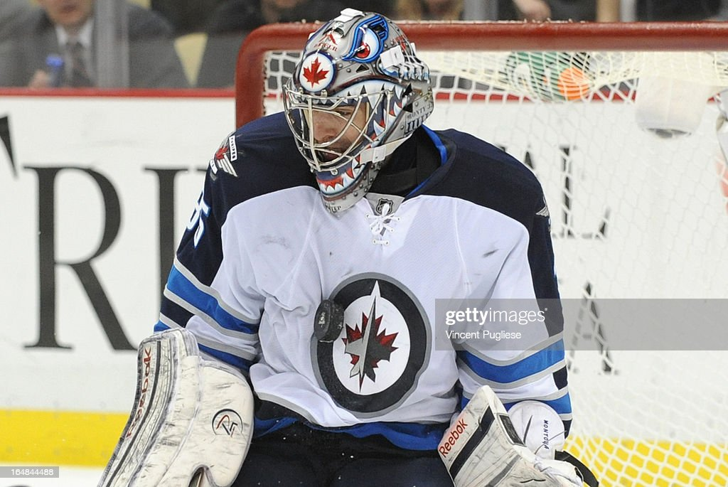 Goalie Al Montoya #35 of the Winnipeg Jets stops a puck with his chest during the third period on February 28, 2013 at the CONSOL Energy Center in Pittsburgh, Pennsylvania.