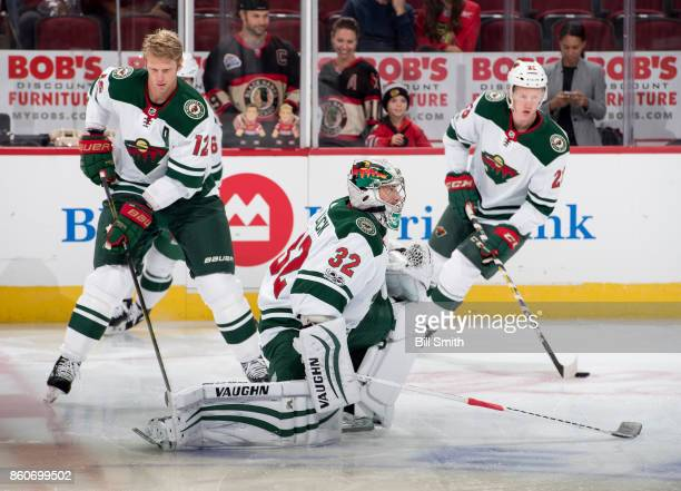 Goalie Alex Stalock of the Minnesota Wild warms up next to Eric Staal prior to the game against the Chicago Blackhawks at the United Center on...