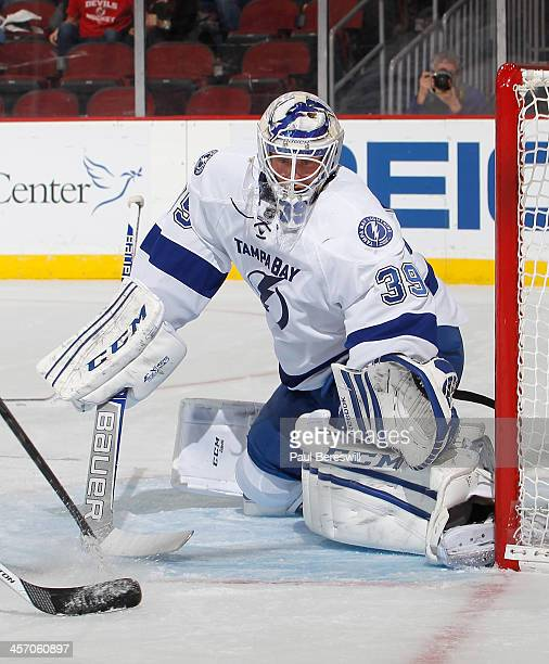 Goalie Anders Lindback of the Tampa Bay Lightning defends his goal during an NHL hockey game against the New Jersey Devils at Prudential Center on...
