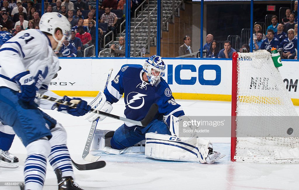 Goalie <a gi-track='captionPersonalityLinkClicked' href=/galleries/search?phrase=Anders+Lindback&family=editorial&specificpeople=7211274 ng-click='$event.stopPropagation()'>Anders Lindback</a> #39 of the Tampa Bay Lightning makes a save while James van Riemsdyk #21 of the Toronto Maple Leafs looks for a rebound during the second period at the Tampa Bay Times Forum on April 8, 2014 in Tampa, Florida.