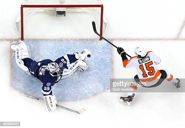 Goalie Anders Lindback of the Tampa Bay Lightning makes a sprawling save against Tye McGinn of the Philadelphia Flyers during the first period at the...