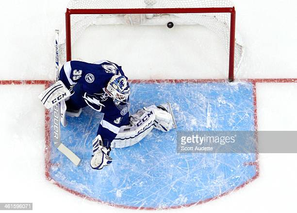 Goalie Anders Lindback of the Tampa Bay Lightning watches the puck go into the net for a goal for the Washington Capitals during the first period at...