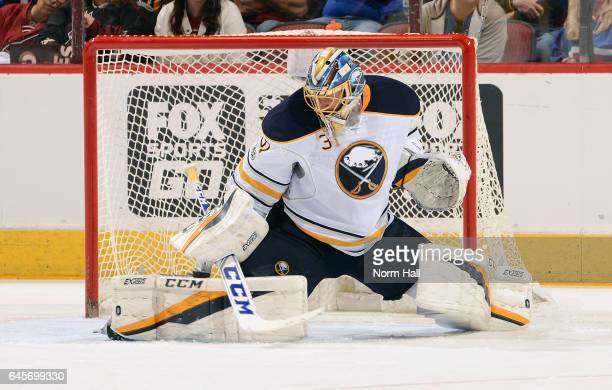 Goalie Anders Nilsson of the Buffalo Sabres makes a pad save on s ahot by the Arizona Coyotes during the second period at Gila River Arena on...