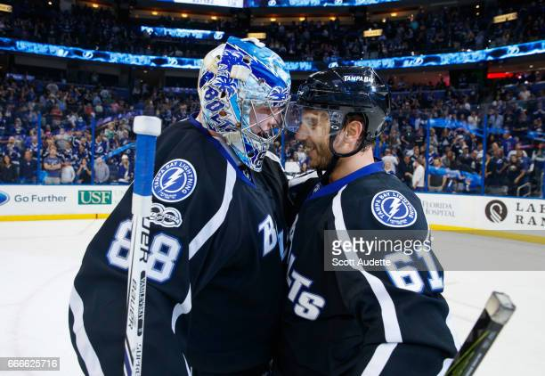 Goalie Andrei Vasilevskiy and Gabriel Dumont of the Tampa Bay Lightning celebrate the win against the Buffalo Sabres at Amalie Arena on April 9 2017...