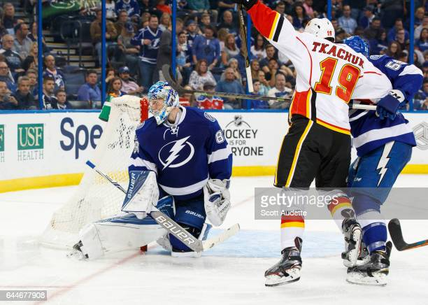 Goalie Andrei Vasilevskiy and Jake Dotchin of the Tampa Bay Lightning react to a goal for Matthew Tkachuk and the Calgary Flames during the second...