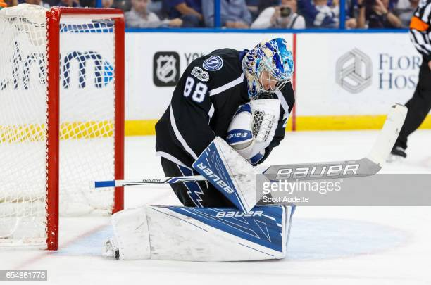 Goalie Andrei Vasilevskiy of the Tampa Bay Lightning cradles the puck for a save against the Washington Capitals during the second period at Amalie...