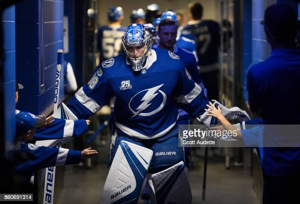 Goalie Andrei Vasilevskiy of the Tampa Bay Lightning is greeted by young fans before the game against the Pittsburgh Penguins at Amalie Arena on...