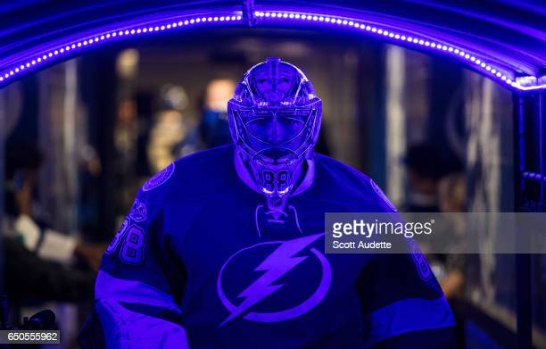 Goalie Andrei Vasilevskiy of the Tampa Bay Lightning leads his team out to the ice for pregame warm ups before the game against the Minnesota Wild at...