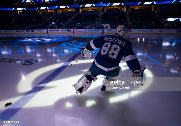 Goalie Andrei Vasilevskiy of the Tampa Bay Lightning leads his team out for pregame warm ups against the Detroit Red Wings at Amalie Arena on October...