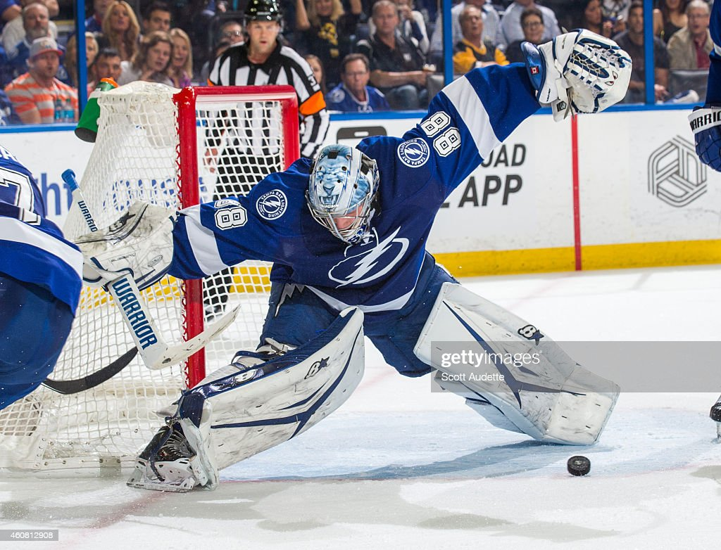 Goalie <a gi-track='captionPersonalityLinkClicked' href=/galleries/search?phrase=Andrei+Vasilevskiy+-+Ice+Hockey+Player&family=editorial&specificpeople=9594320 ng-click='$event.stopPropagation()'>Andrei Vasilevskiy</a> #88 of the Tampa Bay Lightning looks for the puck to make a save against the Pittsburgh Penguins during the second period at the Amalie Arena on December 23, 2014 in Tampa, Florida.