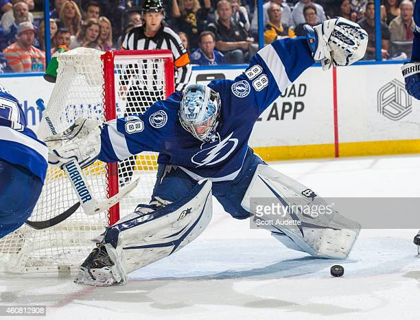 Goalie Andrei Vasilevskiy of the Tampa Bay Lightning looks for the puck to make a save against the Pittsburgh Penguins during the second period at...
