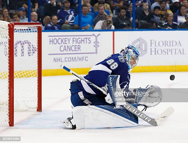 Goalie Andrei Vasilevskiy of the Tampa Bay Lightning looks to make a save against the Boston Bruins during the second period at Amalie Arena on...